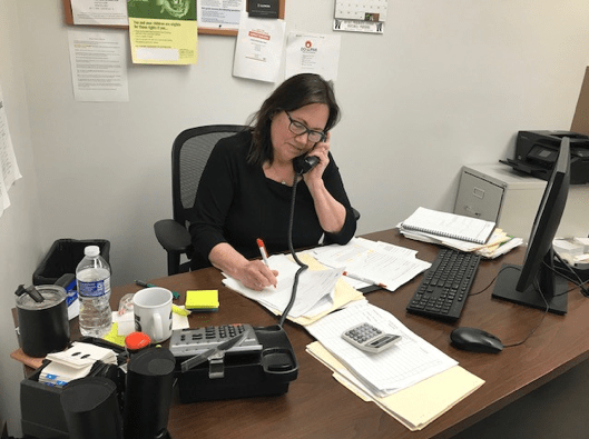 BCMW Case Worker Ginny Dailey takes an application over the phone.