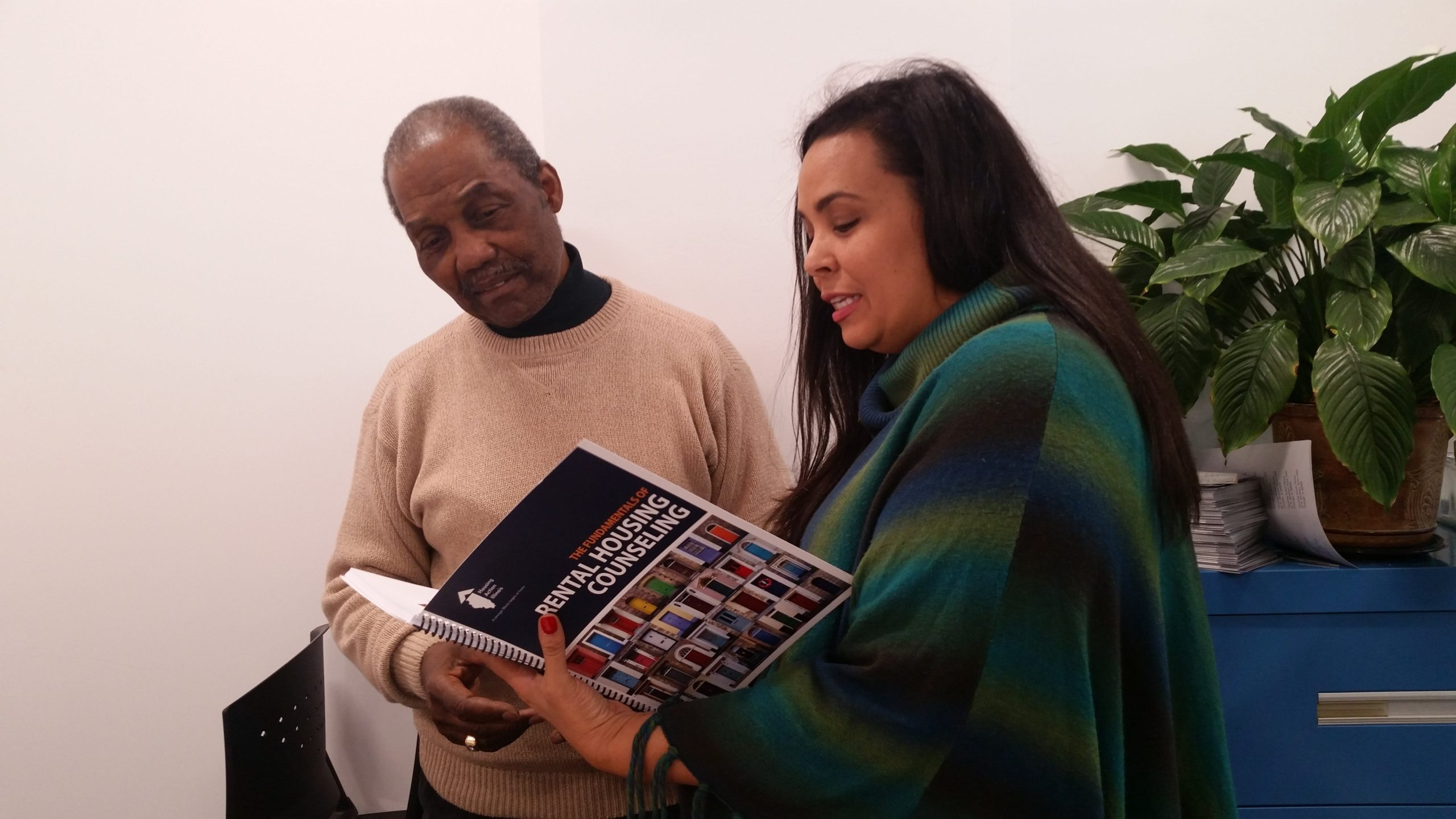 Bibian and Taft looking at rental counseling course book