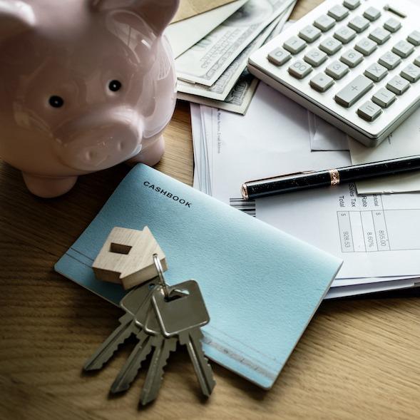 Piggy bank, keys, calculator